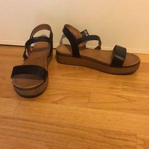 Black flatforms sandals